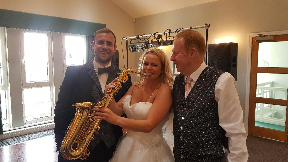 A happy bride trying the sax